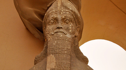 Partial view of an ancient statue dated from the Assyrian civilization, at the archaeological site of Nimrud that lies on the Tigris River southeast of Mosul, Iraq ( AFP Photo / Hubert Debbasch)