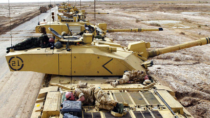 British soldiers of the Royal Scots Dragoon Guards, Armoured Regiment, take a break.(Reuters / STR)