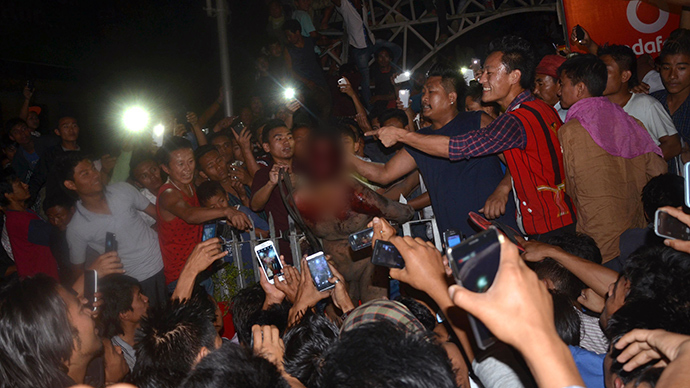 A crowd of Indian men surround an alleged rapist after he was dragged out of prison and beaten to death in Dimapur in the northeastern Indian state of Nagaland on March 5, 2015 (AFP Photo / Caisii Mao)