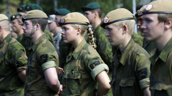 "Norwegian army soldiers attend a NATO military exercise ""Saber Strike"" ceremony in Adazi June 9, 2014. (Reuters/Ints Kalnins)"