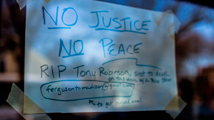 A sign in a store window pays tribute to a 19-year-old black man killed by police, at the 1100 block of Williamson Street in Madison, Wisconsin.(Reuters / Tom Lynn)