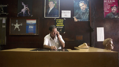 Enrique Alvares, 73, talks on the phone in downtown Havana (Reuters / Alexandre Meneghini)