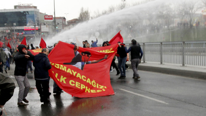 Protesters run from water cannons used by riot police to disperse them during a protest march to commemorate the death of Berkin Elvan, in Istanbul March 11, 2015. (Reuters / Osman Orsal)