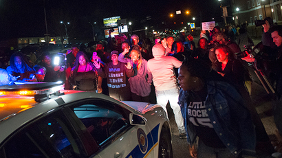 Protestors block a police vehicle from entering the City of Ferguson Police Department and Municipal Court parking lot in Ferguson Missouri, March 11, 2015 (Reuters / Kate Munsch)