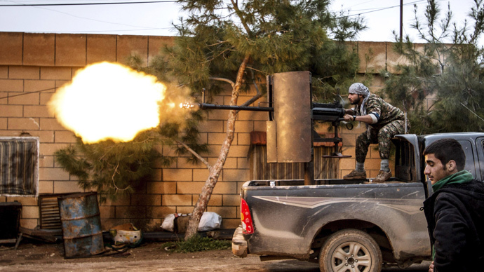 A fighter of the Kurdish People's Protection Units (YPG) fires an anti-aircraft weapon from Tel Tawil village in the direction of Islamic State fighters positioned in the countryside of the town of Tel Tamr, Syria (Reuters / Rodi Said)