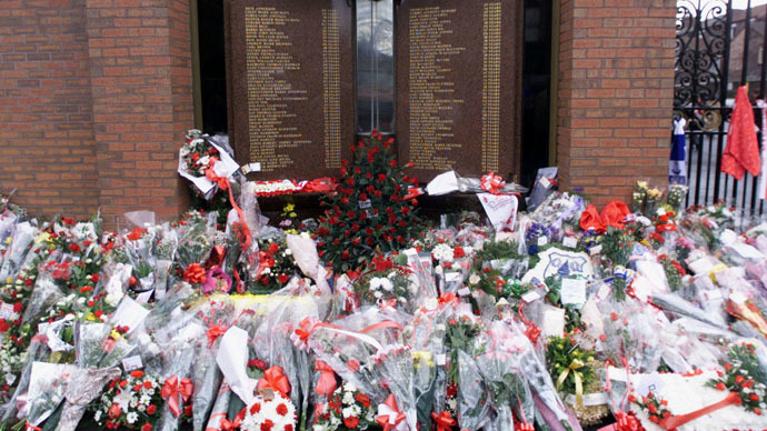 Floral tributes surround the memorial to the victims of the Hillsborough disaster outside the Anfield soccer stadium (Reuters)