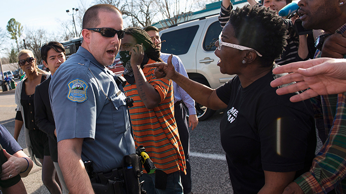 Ferguson police try to separate Michael Brown supporters from Ferguson police supporters, outside the Ferguson Police Department and Municipal Court in Ferguson, Missouri, March 15, 2015 (Reuters / Kate Munsch)