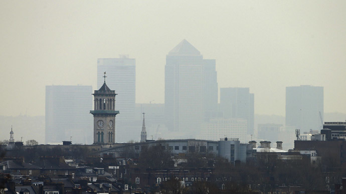 Smog surrounds the Canary Wharf financial district in London April 3, 2014. (Reuters / Suzanne Plunkett)