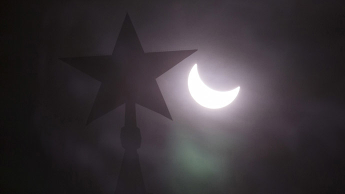 A star on the top of the tower of the Kremlin is seen during a partial solar eclipse in central Moscow, March 20, 2015. (Reuters / Tatyana Makeyeva)
