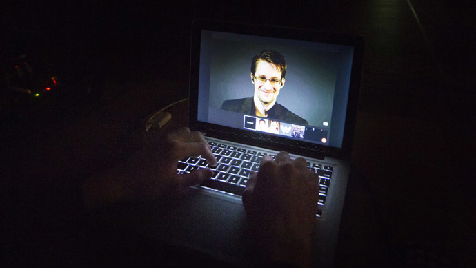 A student works on a computer that is projecting former U.S. National Security Agency contractor Edward Snowden. (Reuters / Mark Blinch)
