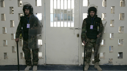 Iraqi guards stand guard at a gate in Baghdad's Abu Ghraib. (Reuters / Mohammed Ameen)
