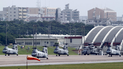 Four Sea Knight transport helicopters and a Super Stallion helicopter are parked at Marine Corps Air Station Futenma in Ginowan on Okinawa.(Reuters / Toru Hanai)