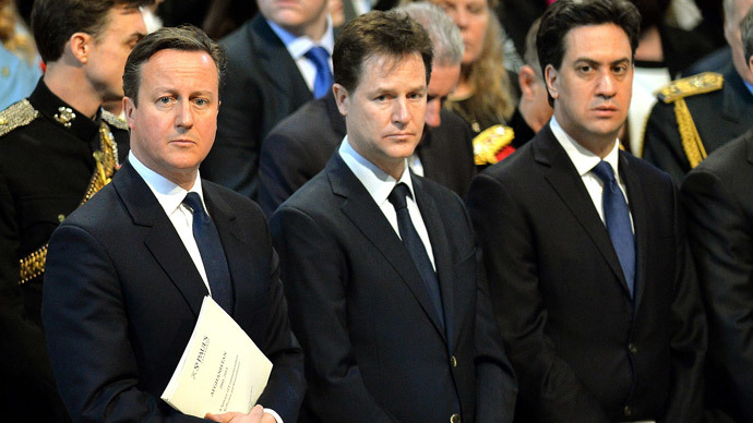 Britain's Prime Minister David Cameron (L) stands alongside Deputy Prime Minister Nick Clegg, and Ed Miliband the leader of the opposition Labour Party in central London. (Reuters / John Stillwell )