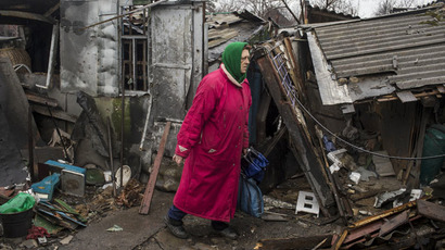 A woman stands in front of her destroyed house in the town of Debaltseve, north-east from Donetsk, March 13, 2015. (Reuters/Marko Djurica)
