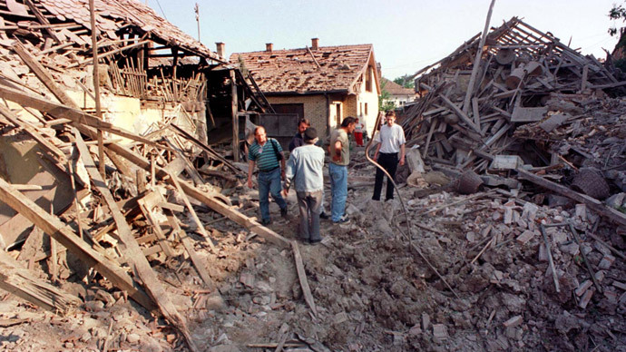 Residents stand on the rubble of houses in town of Cuprija, some 100km (65 miles) south of Yugoslav capital of Belgrade where 11 people were injured, five of them seriously including four women, after nine NATO missiles struck the centre of the town early May 29,1999.(Reuters)