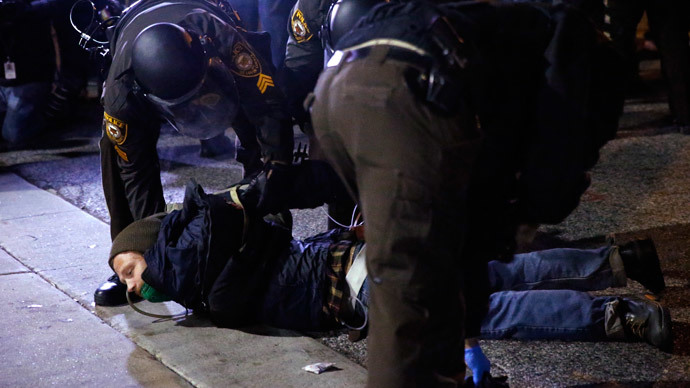 A protester is arrested in front of the Ferguson Police Department, in Ferguson, Missouri, November 25, 2014.(Reuters / Jim Young)