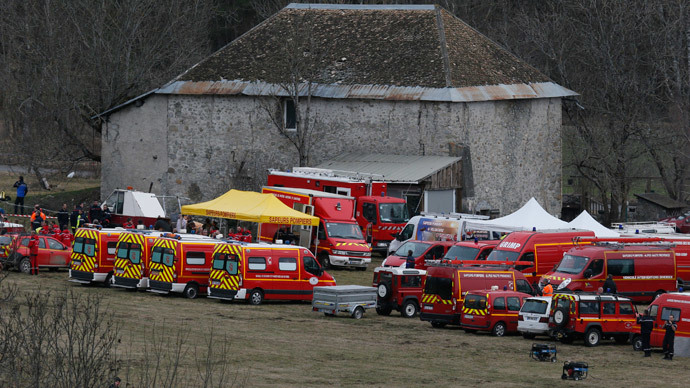 French fire brigade rescue units gather in a field near a farm buidling as they prepare to reach the crash site of an Airbus A320, near Seyne-les-Alpes, in the French Alps, March 24, 2015.(Reuters / Robert Pratta)