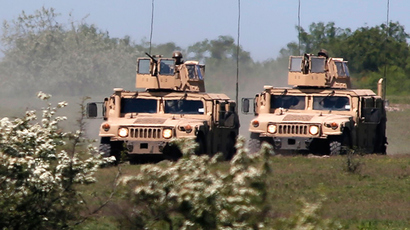 Humvee vehicles (Reuters / Bogdan Cristel)
