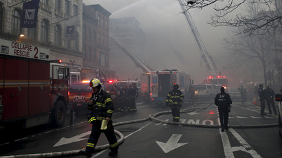 New York City Fire Department firefighters battle an active fire at the site of a residential apartment building collapse in New York City's East Village neighborhood March 26, 2015.  (Reuters / Mike Segar)
