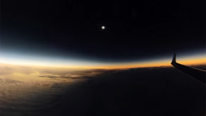 In the shadow of the moon: Spectacular plane's view of the solar eclipse (VIDEO)