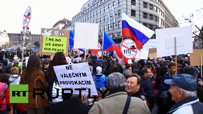 """Anti-NATO demonstrators protest against the US Army's """"Dragoon Ride"""" military exercise in Prague March 28, 2015 (A still from Ruptly video)"""