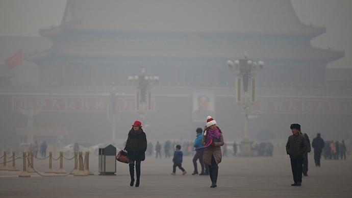 Visitors take a walk during a polluted day at Tiananmen Square in Beijing (Reuters / Kim Kyung-Hoon)