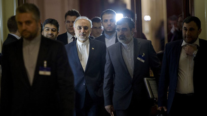 Head of Iranian Atomic Energy Organization Ali Akbar Salehi walks with others during a break in a meeting with world representatives seeking to pin down a nuclear deal with Iran at the Beau Rivage Palace Hotel in Lausanne March 31, 2015. (Reuters/Brendan Smialowski)