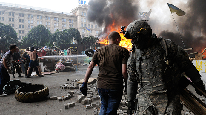 ARCHIVE PHOTO: Burning car tires set on fire on Independence Square (Maidan) in Kiev by Maidan activists protesting the removal of barricades and a tent camp from the square (RIA Novosti / Alexandr Maksimenko)