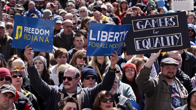 Demonstrators gather at Monument Circle to protest a controversial religious freedom bill recently signed by Governor Mike Pence, during a rally in Indianapolis March 28, 2015. (Reuters/Nate Chute)