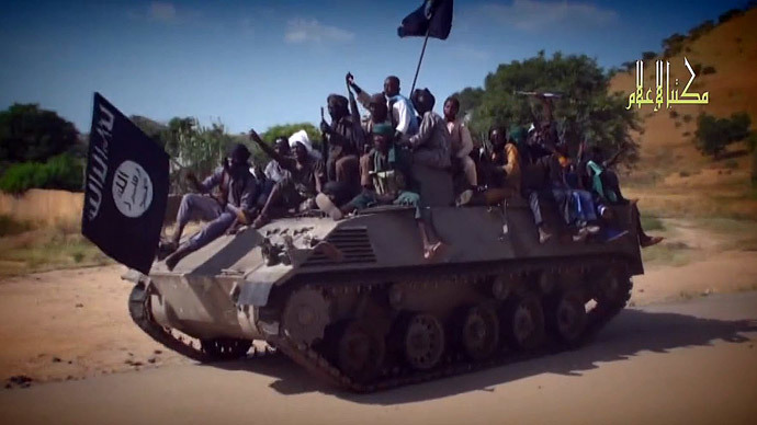 Boko Haram fighters parading on a tank in an unidentified town.(AFP Photo / HO / Boko Haram)
