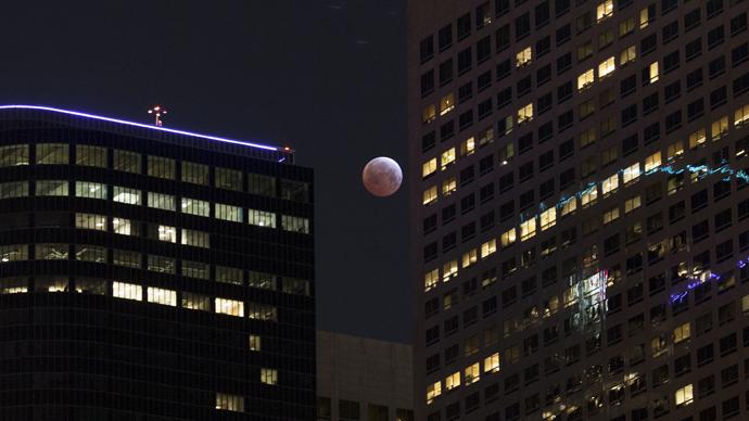 Shortest lunar eclipse of the century delights millions (PHOTOS)