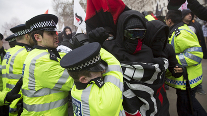 A protester clashes with police as anti-fascist demonstrators stage a counter demonstration during a PEGIDA (Patriotic Europeans Against the Islamisation of the West) rally on Whitehall in central London April 4, 2015. (Reuters / Neil Hall)