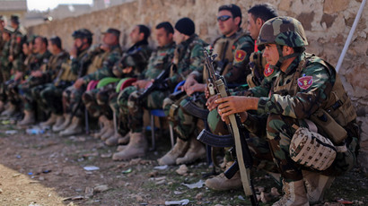 Kurdish Peshmerga fighters rest during fighting against Islamic State (IS) group. (AFP Photo / Ahmed Deeb)