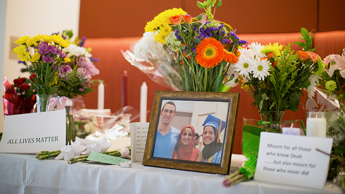 A makeshift memorial for Deah Shaddy Barakat, his wife Yusor Mohammad and Yusor's sister Razan Mohammad Abu-Salha, who were killed by a gunman (Reuters / Chris Keane)