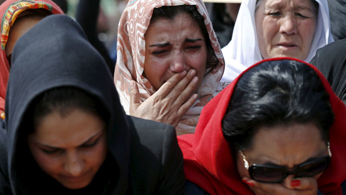 Afghan women's rights activists mourn during the burial ceremony of Farkhunda, an Afghan woman who was beaten to death and set alight on fire on Thursday, in Kabul March 22, 2015. (Reuters/Mohammad Ismail)