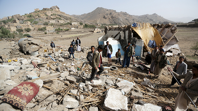 People gather around the wreckage of a house destroyed by an air strike in the Bait Rejal village, west of Yemen's capital Sanaa April 7, 2015. (Reuters / Khaled Abdullah)