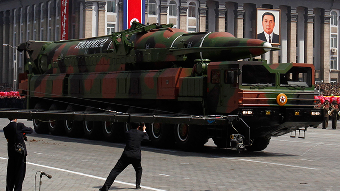 State media film a rocket carried by a military vehicle during a military parade to celebrate the centenary of the birth of Kim Il-sung in Pyongyang April 15, 2012.  (Reuters / Bobby Yip)