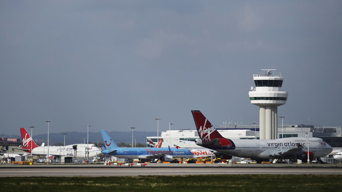Passenger airplanes are seen grounded at Gatwick Airport in London. (Reuters/Luke MacGregor)
