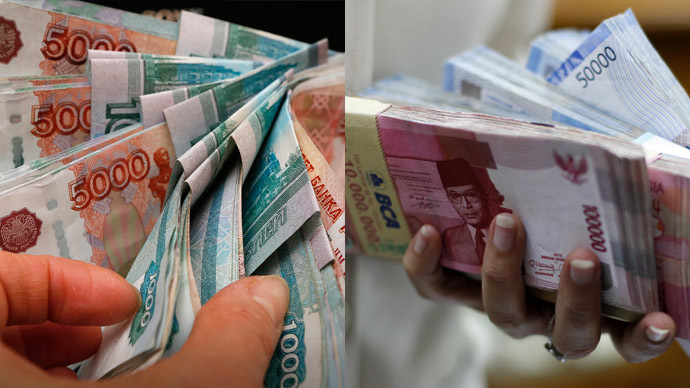 Russian rouble banknotes and Indonesian rupiah banknotes (Reuters/Ilya Naymushin/Beawiharta)