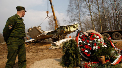 ARCHIVE PHOTO: A serviceman stands guard while a crane lifts the wreckage at the site of the Tupolev Tu-154 aircraft crash, with wreaths left in memory of the victims, in Smolensk April 14, 2010.(Reuters / Sergei Karpukhin)