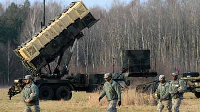 U.S soldiers walk next to a Patriot missile defence battery during join exercises at the military grouds in Sochaczew, near Warsaw, March 21, 2015. (Reuters/Franciszek Mazur/Agencja Gazeta)
