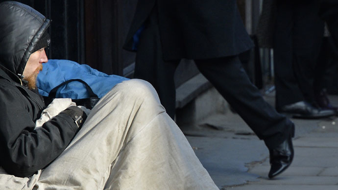 A homeless man sits on a pavement in central London (Reuters/Melville)