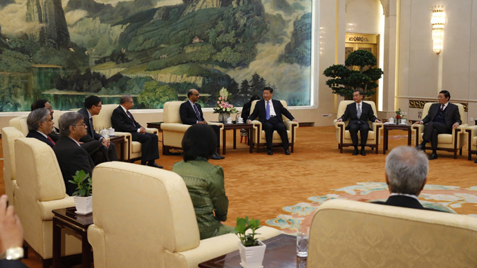 China's President Xi Jinping (3rd R) meets with the guests at the Asian Infrastructure Investment Bank launch ceremony at the Great Hall of the People in Beijing October 24, 2014. (Reuters/Takaki Yajima)