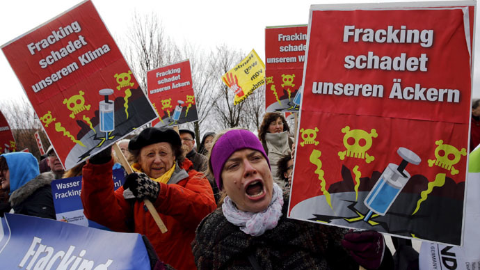 Environmental activists hold signs during a protest against fracking technology in front of the Chancellery in Berlin, April 1, 2015. (Reuters/Fabrizio Bensch)