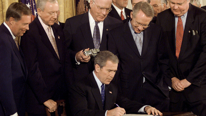 President George W. Bush signs the Patriot Act Anti-Terrorism Bill into law during a ceremony at the White House, October 26, 2001. (Reuters / Kevin Lamarque)