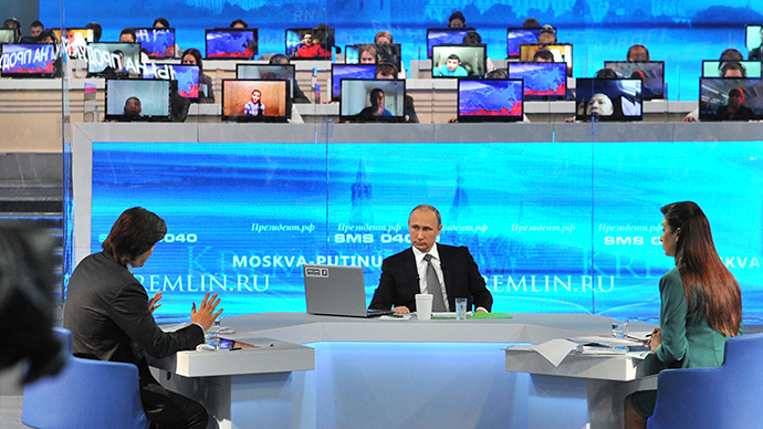 April 16, 2015. Russian President Vladimir Putin (center) answers questions from the public during the annual Q&A session live on Russian television and radio.  (RIA Novosti / Michael Klimentyev)