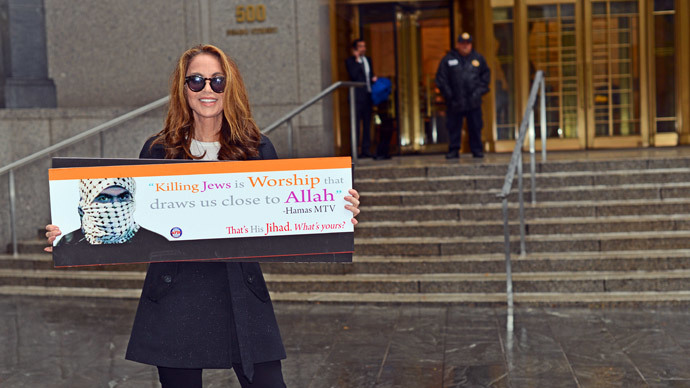 AFDI president Pamela Geller holds the controversial placard (Photo: AFDI)