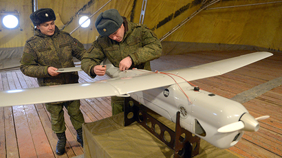 Cadets of the Defence Ministry's State Center of Unmanned Aviation during preparations for the launch of the Orlan-10 unmanned aerial vehicle at a training field in the Moscow Region (RIA Novosti / Evgeny Biyatov)