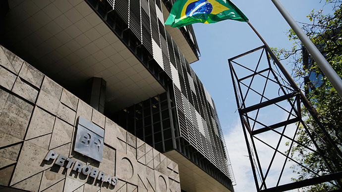 A tower with a Brazilian flag representing an oil rig is pictured during a protest in front of the Petrobras headquarters in Rio de Janeiro (Reuters / Sergio Moraes)