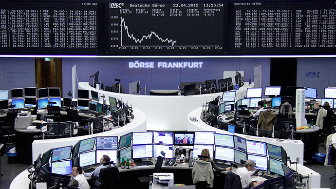 Traders work at their screens in front of the German share price index DAX board at the stock exchange in Frankfurt April 23, 2015 (Reuters / Stringer)